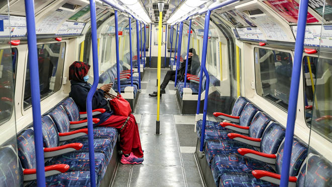 File photo: Passengers wear face masks on the London Underground