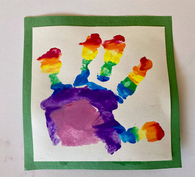 The young royal made a handprint with the paints