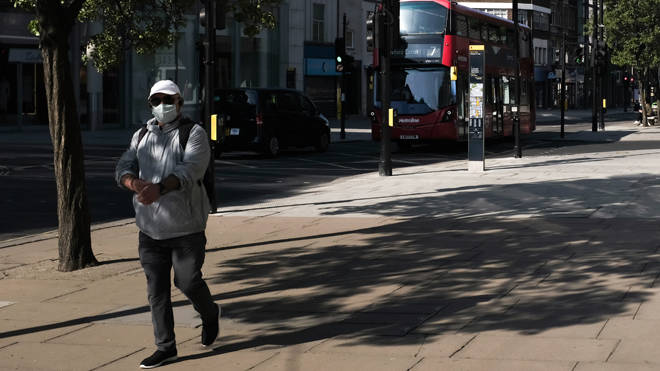 A man walks down empty Oxford Street in central London during the coronavirus lockdown