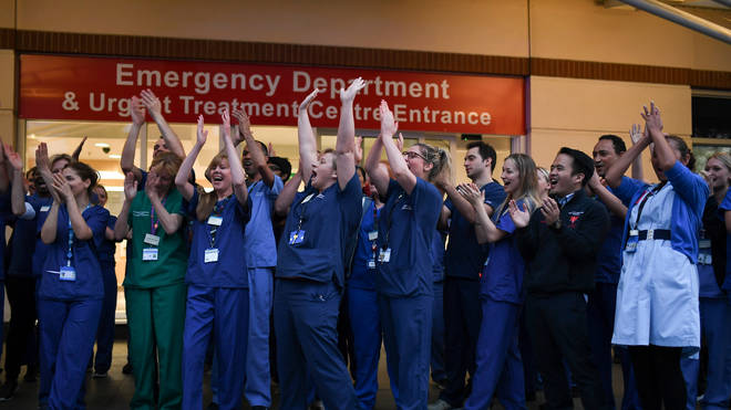 """File photo: NHS staff applaud outside the Chelsea and Westminster Hospital in London during the weekly """"Clap for our Carers"""""""