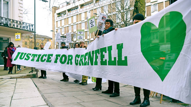 Protesters outside the Grenfell Tower public inquiry in London