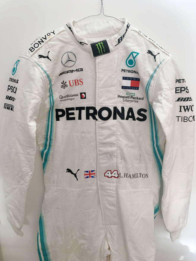 Lewis Hamilton's race suit raised £12,000