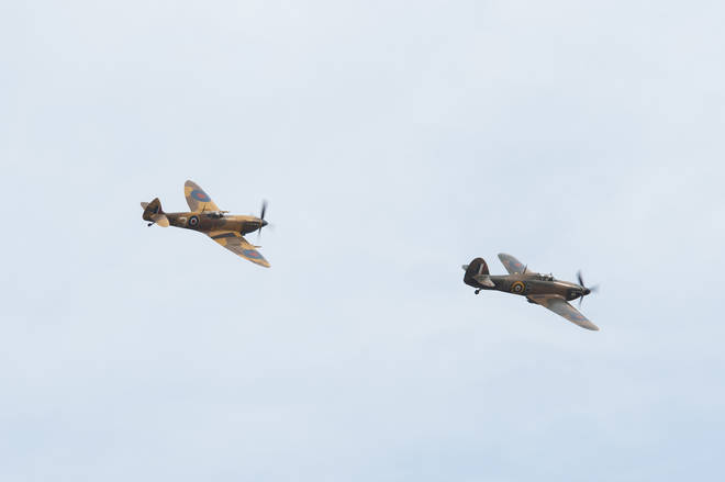 A Battle of Britain Memorial Flight flypast of a Spitfire and a Hurricane passes over the home of Second World War veteran Captain Tom Moore