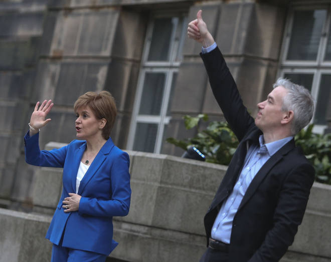 Dr Gregor Smith, pictured with Ms Sturgeon, said he would also urge caution on the claim