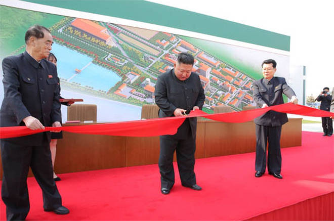 Kim Jong-Un reportedly cuts the ribbon at a fertiliser factory in Sunchon on Friday