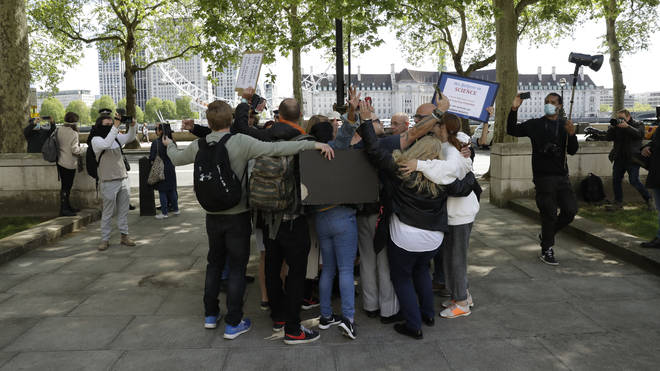 Protesters hugged in defiance of coronavirus lockdown laws