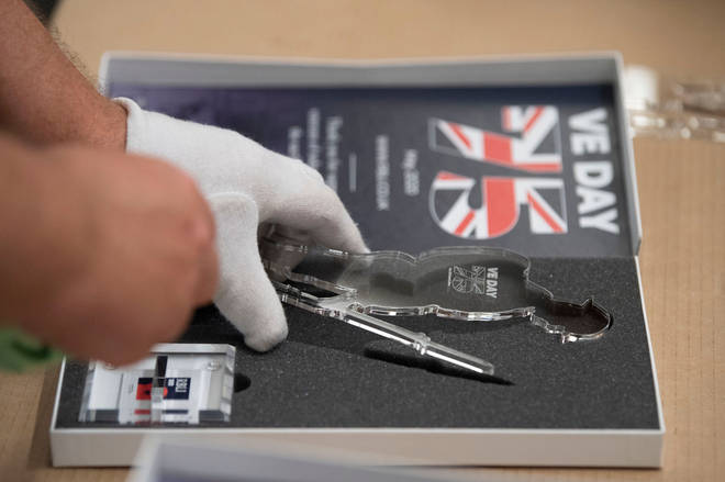 """Assembled commemorative """"Tommy"""" figures are prepared for shipping at the Royal British Legion Industries"""