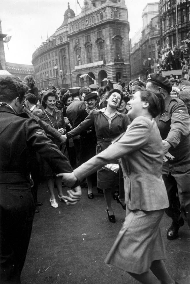 Jubilant Londoners dancing in Piccadilly Circus on VE Day
