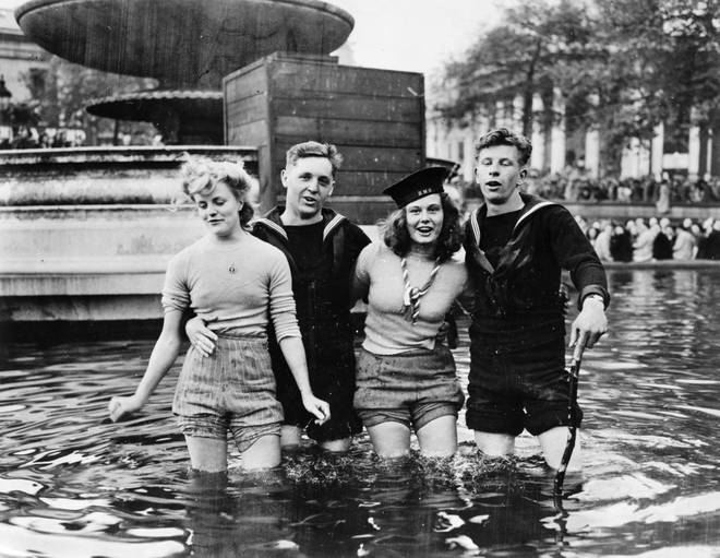 Young adults in Trafalgar cooled off during the celebrations by wading in the fountains