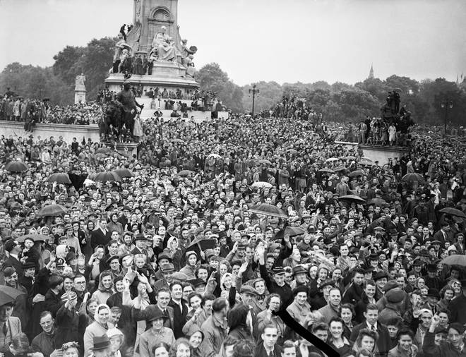 Some of the crowd pictured outside Buckingham Palace