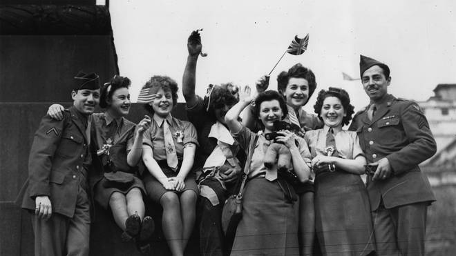 A group of ATS and American soldiers celebrate VE Day in Trafalgar Square