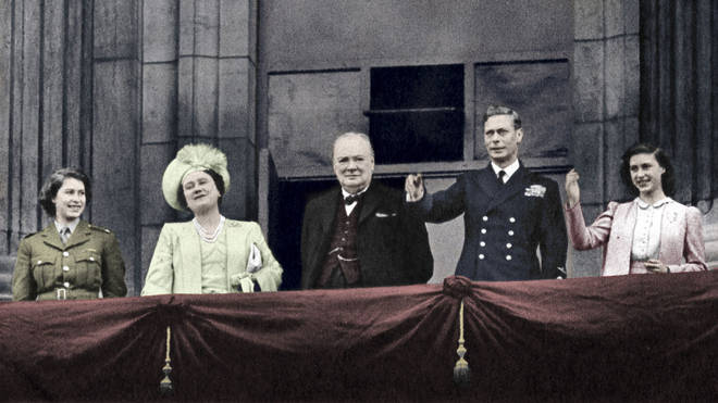 Prime Minister Winston Churchill appears on the balcony at Buckingham Palace together with King George VI and Queen Elizabeth and the two princesses