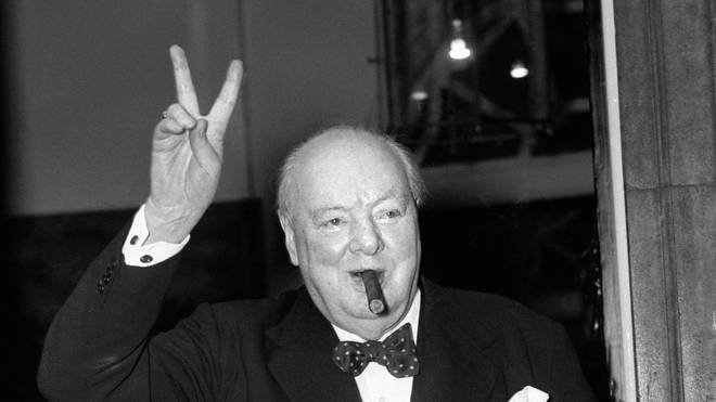 Winston Churchill giving his iconic V for Victory sign