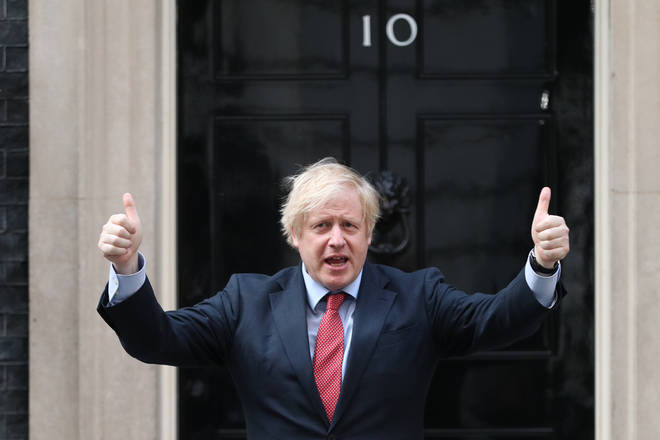 Boris Johnson stood outside Downing Street to join the applause