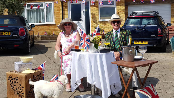 A couple in Northampton celebrate VE Day on their driveway