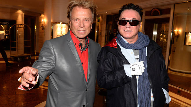 Magicians Siegfried (L) and Roy (R) pose at hotel Bayerischer Hof in Munich