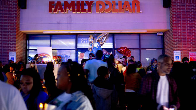A vigil outside the supermarket fore Calvin Munerlyn, the security guard who was shot dead
