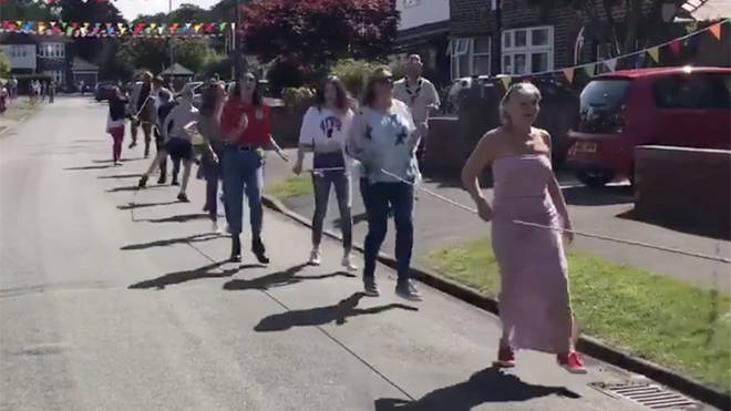 Residents take part in the 'socially distanced' conga line
