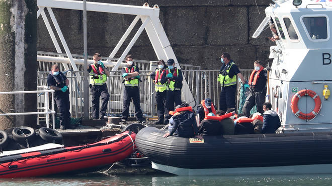 Border Force officers prepare to bring to shore men thought to be migrants in Dover, Kent, after small boat incidents in The Channel on Saturday