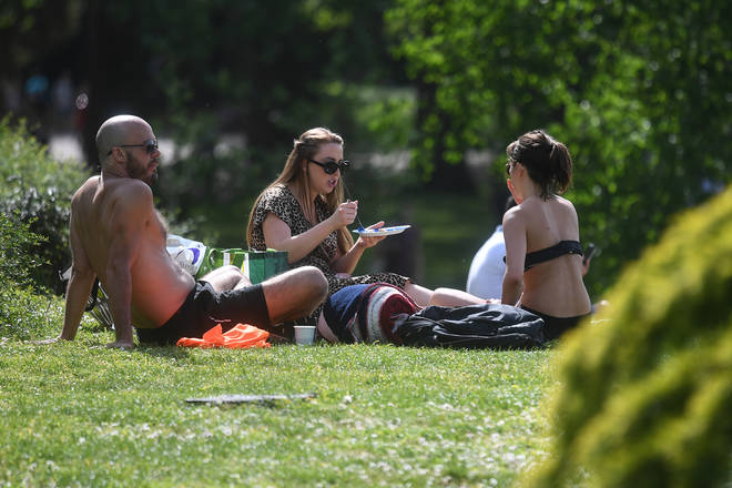 Friends and family can now meet under new coronavirus lockdown rulessit in the sun in Battersea Park