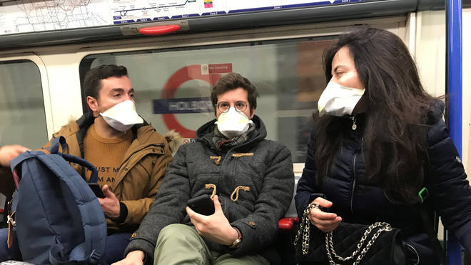 People have bene urged to wear face masks in shops and on public transport