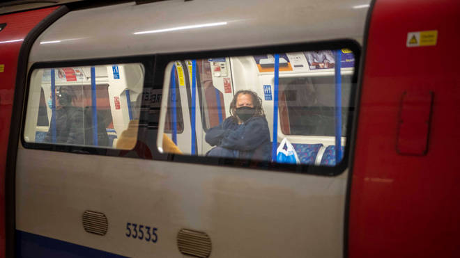 A Tube passenger wears a face mask on the Northern Line