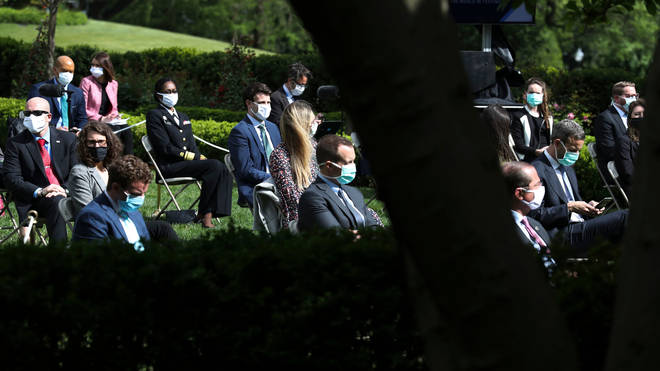 Other attendees wore masks to the White House press conference