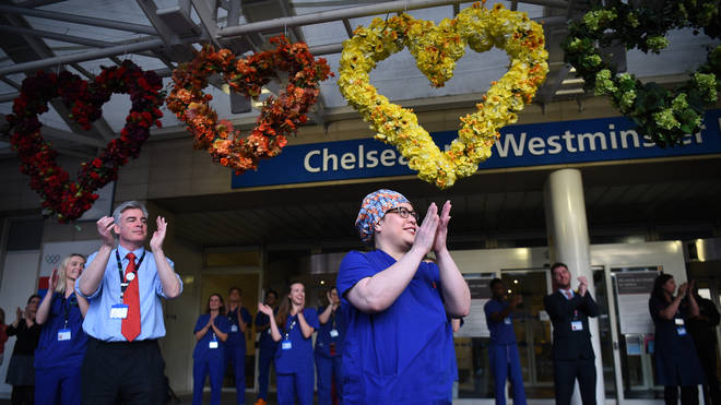 File photo: Medical staff outside the Chelsea and Westminster Hospital, London, join in the applause during Thursday's nationwide Clap for Carers