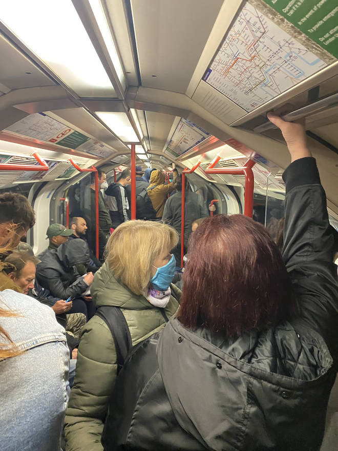Commuters crowd inside a tube train on the London Underground on Thursday