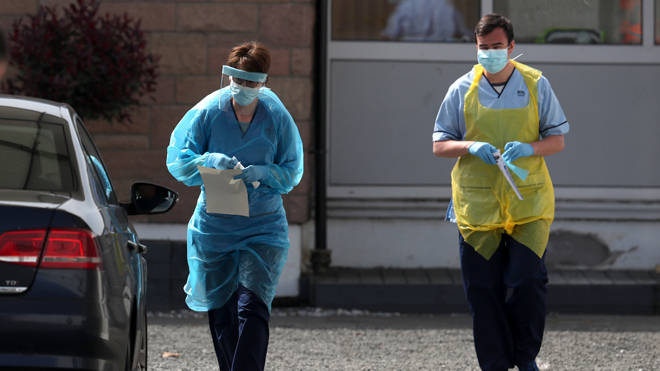 A nurse prepares to take a sample at a COVID 19 testing centre in the car park of the Bowhouse Community Centre in Grangemouth