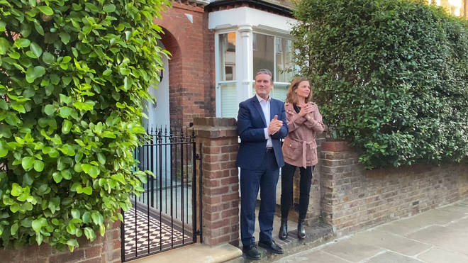 Labour leader Sir Kier Starmer and his wife Victoria outside their home, as they join in the applause