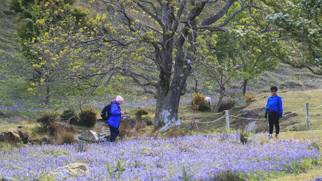 Walkers take a stroll at Rannerdale Knotts in the Lake District, Cumbria, on the first day of lifting of coronavirus lockdown restrictions