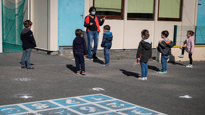 Children socially distance in a playground in France