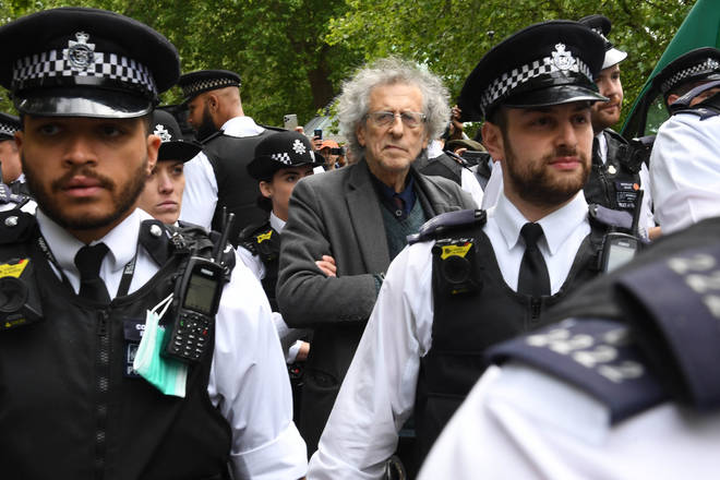 Police lead away Piers Corbyn, brother of former Labour leader Jeremy Corbyn, as protesters gather in breach of lockdown rules in Hyde Park