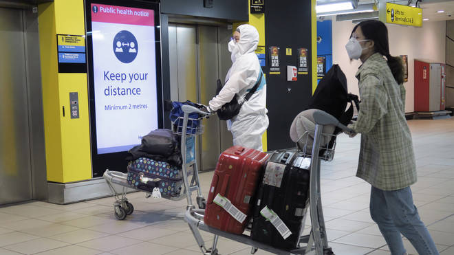 Passengers wearing PPE at Heathrow Airport