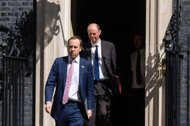 Health Secretary Matt Hancock and Chief Medical Officer Professor Chris Whitty leave 10 Downing Street