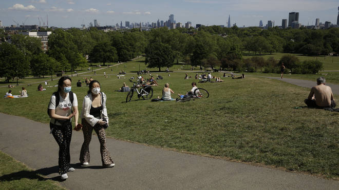 People relax on Primrose Hill on Wednesday