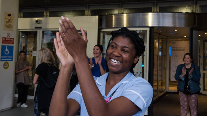 A nurse claps her hands outside Chelsea and Westminster Hospital to take part in the weekly 'clap for our carers' applause
