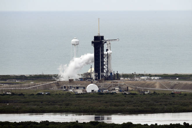 A SpaceX Falcon 9, with NASA astronauts Doug Hurley and Bob Behnken in the Dragon crew capsule
