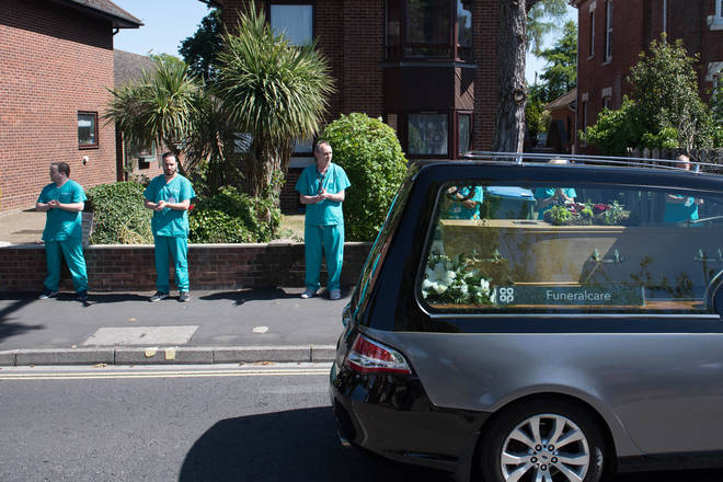 Mike's herse passed his colleagues as they clap