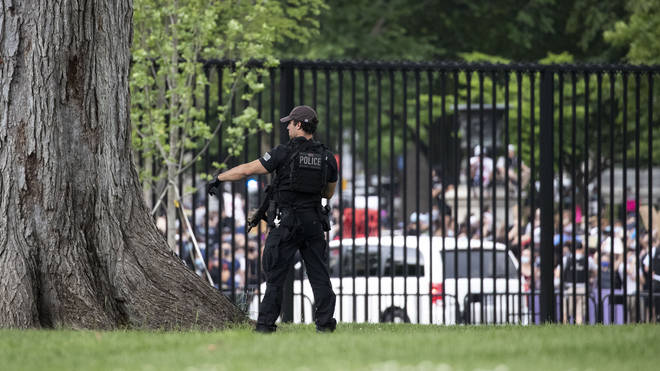 Crowds are seen from inside the White House perimeter on Friday