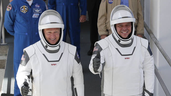 Nasa astronauts Douglas Hurley, left, and Robert Behnken walk out of the Neil A. Armstrong Operations and Checkout Building