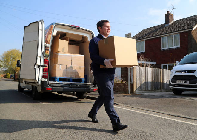 Robert Jenrick, pictured delivering care boxes, is expected to lay out more details during Sunday's press conference