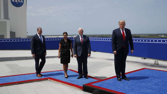 Donald Trump and the Vice President and Second Lady take their places to watch the launch