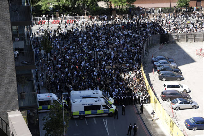 The protesters were blocked by police as they went towards the American Embassy