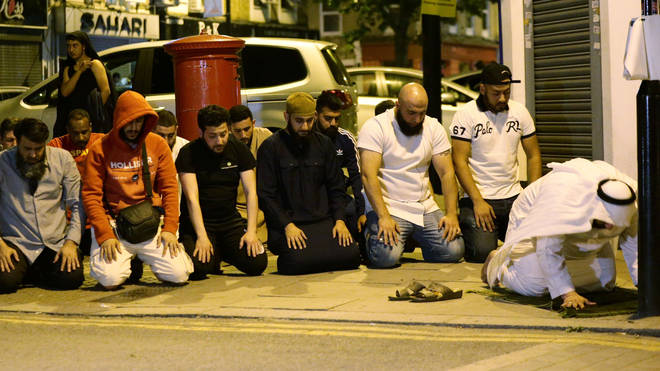 Muslims pray on the street after Finsbury Park collision