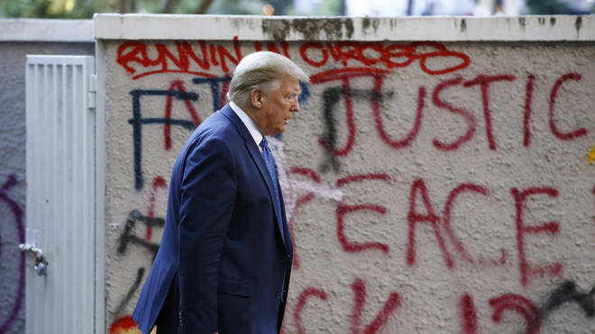 "He walked past graffiti, much of which said ""F**k Trump"""