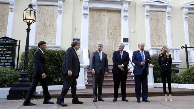 He gathered those in his administration around him for another picture - although Vice President Mike Pence was notably absent