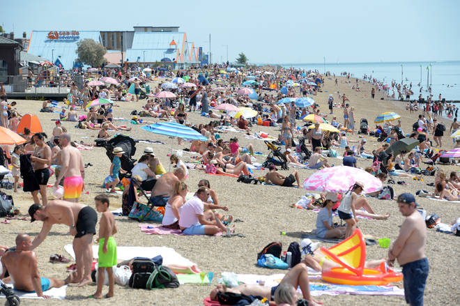 People enjoying the good weather on the beach at Southend-on-Sea in Essex