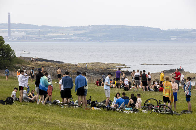 Groups of people on Crawfordsburn beach in County Down, despite the coronavirus restrictions.